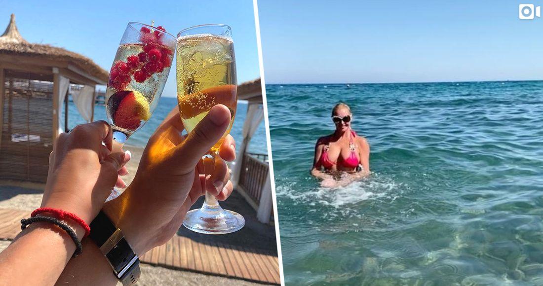 Мужская рука с бокалом шампанского появилась на отдыхе Волочковой в Турции